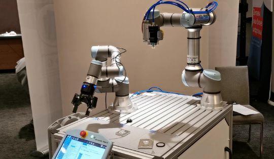 """Робоячейка с двумя роботами Universal Robots ООО НПП """"ВИТА-ПРИНТ"""""""